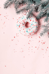 Fototapete - Christmas ball made of glazed donut and sugar sprinkling. Christmas creative background