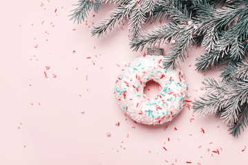 Fototapete - Christmas creative background. Christmas ball made of decorated donut and sugar sprinkling