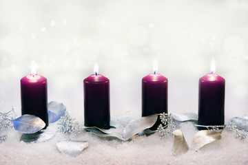 Fourth Advent, 4 burning candles with silvery decoration, copy space