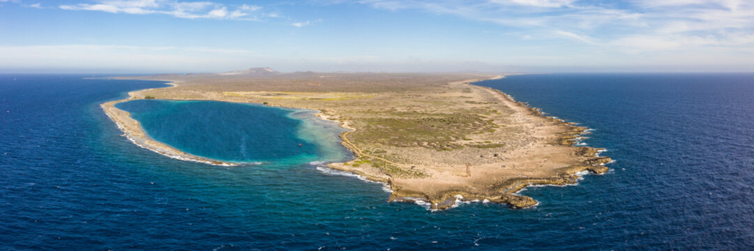 Aerial view of coast of Curaçao in the Caribbean Sea with turquoise water, cliff, beach and beautiful coral reef around Eastpoint