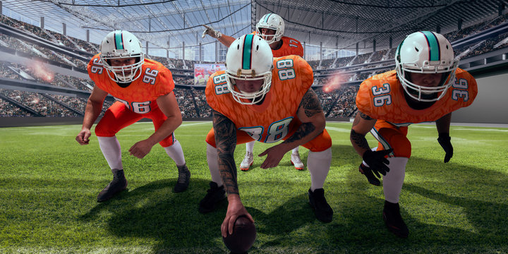 American football players in professional stadium.