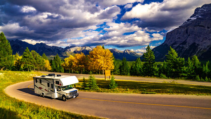 Recreational Vehicle Driving on Autumn Highway In Beautiful Mountains Wilderness Wall mural