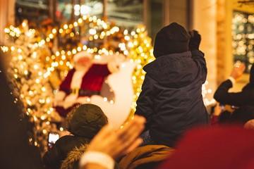 Child waving to santa