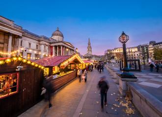 London, England, Uk - Christmas scene outdoors in Trafalgar square Market at blue hour in winter season