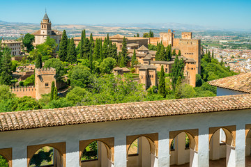 Panoramic sight with the Alhambra Palace and the Albaicin district in Granada as seen from the Generalife Palace. Andalusia, Spain.