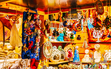 Christmas Ceramics Decorations on Christmas Market at Riga, Latvia. Advent Fair, and Stalls with Crafts Items in Bazaar. Night street Xmas and holiday fair in European city or town, December.