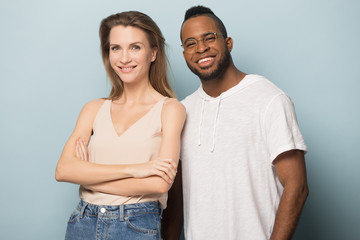 Smiling African American man and woman posing for photo together