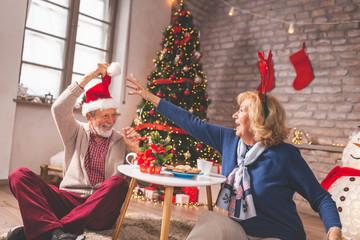 Senior couple having fun celebrating Christmas