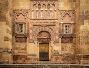 A beautiful wall decoration with stone carving outside The Mosque–Cathedral of Cordoba