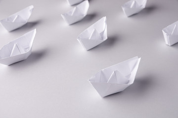 paper ships on a white background. Place for text