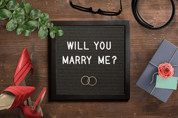 """letter board with proposal text """"will you marry me?"""""""