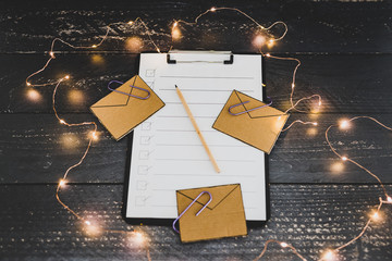 inbox and business schedule concept, email envelope icons scattered on top of to do list on clipboard