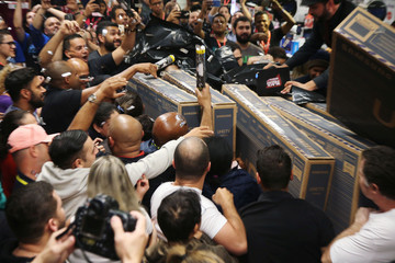 Shoppers push carts before make their purchase in a store during Black Friday in Sao Paulo