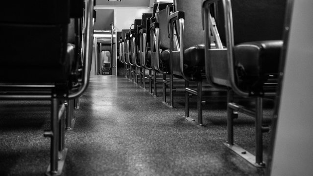 seats in an empty subway carriage