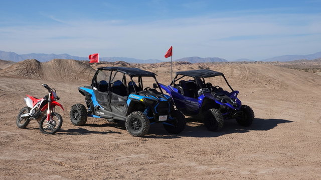 Ocotillo Wells, CA / USA - November 26, 2019: Dune buggies and a dirt bike parked in the sand.