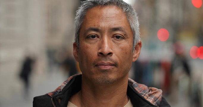Middle aged man in city face portrait
