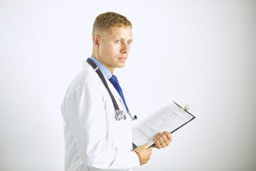 Young confident doctor in a white coat with a stethoscope