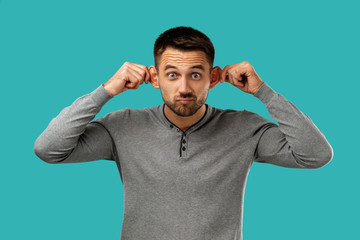 portrait of funny bearded man fooling around isolated on blue background.