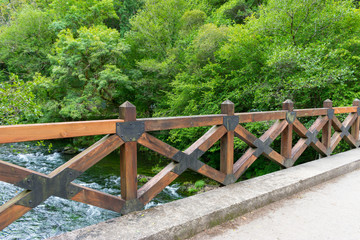 wooden railing on bridge over the river Eume in the Fragas do Eume