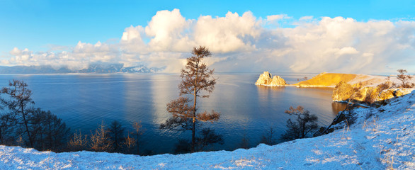 Baikal Lake in December. Panoramic view of the natural landmark - Shamanka Rock or Burhan Cape at sunset. Beautiful Landscape of Olkhon Island