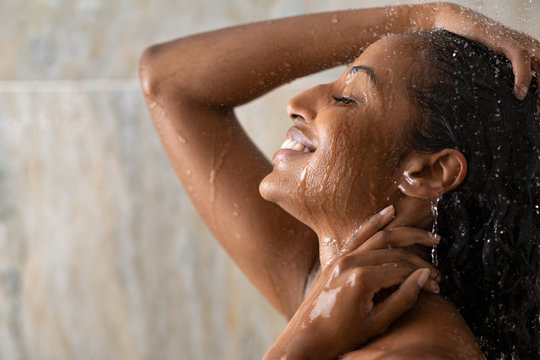 Black beautiful girl relaxing in the shower