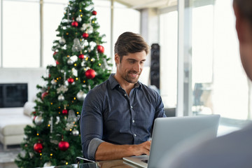 Businessman working during christmas time