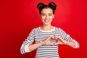 Portrait of positive cheerful girl make hart fingers her passionate love sign wear casual style...