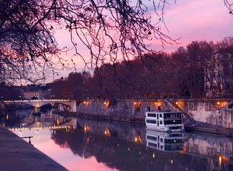 Fotobehang - Evening on the embankment by the Tiber River. Rome. Italy. City landscape.