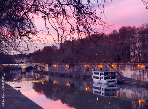 Fotobehang Evening on the embankment by the Tiber River. Rome. Italy. City landscape.