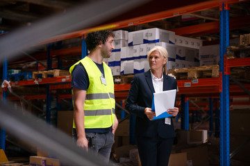 Supervisor and employee at warehouse