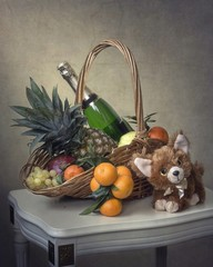 Christmas still life with fruits and champagne