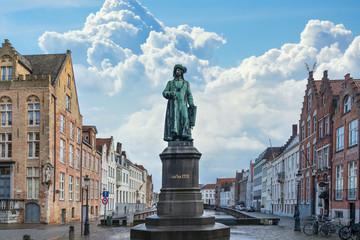 Statue of the Flemish painter Jan van Eyck in Bruges, Belgium
