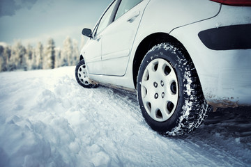 Snow covered tire on snowy road