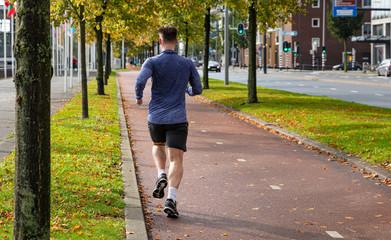 Foto auf Gartenposter Rotterdam Man running in the city center, Rotterdam Holland