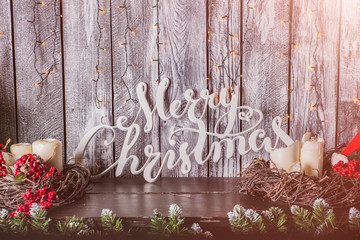 Merry Christmas text in snow and retro style on a white wooden   background. Winter or Christmas...