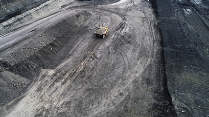 mining truck is driving along a mountain road.
