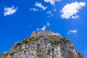 Walls of Saracen castle on a rocky hill in Taormina city, Sicily Island, Italy