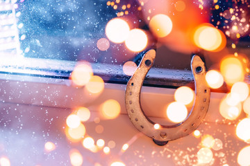 silver horseshoe in the lights. beautiful magical picture for good luck