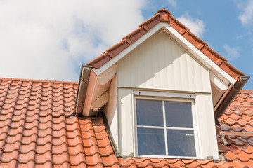 Dormer window with metal cladding in wood look
