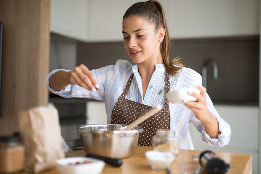 Young woman in kitchen preparing lunch
