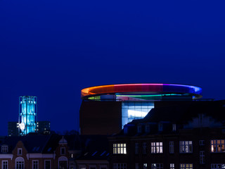 Modern Art Museum Aros, Rainbow and Aarhus City Hall in the blue hour skyline.