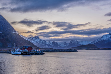 Beautiful view of a red fishing house and a boat, near Hamberg harbour, Lofoten Islands, Norway, Scandinavia, Europe