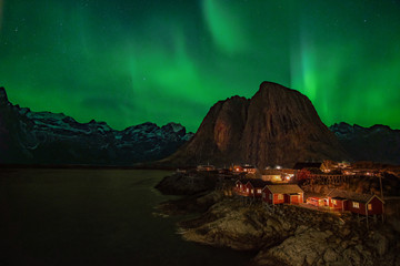 Northern Lights, Aurora Borealis, with classic view of Hamnoy, near Reine on Lofoten Islands, Norway, Scandinavia