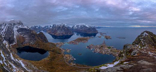 Beautiful panoramic view from Reinebringen edge on stunning mountains and village of Reine, Lofoten Islands, Norway
