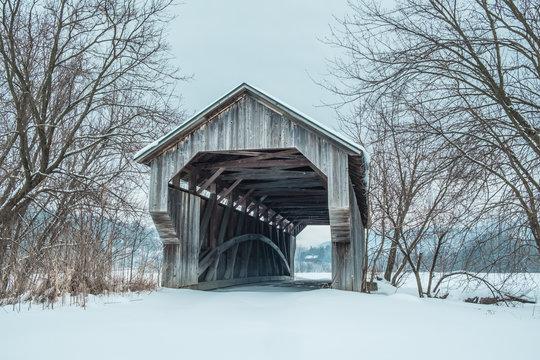 Covered Bridge during winter, Vermont, USA.