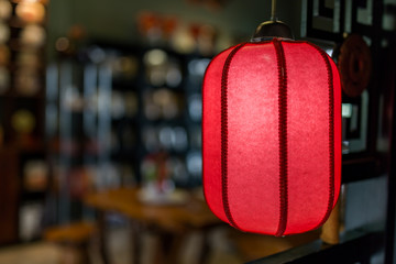 red chinese style lantern hanging in door, Chinese lanterns or paper lights,  Chinese New Year traditional red paper lanterns.