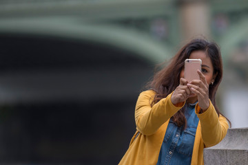 beautiful black hair latina girl taking a selfie