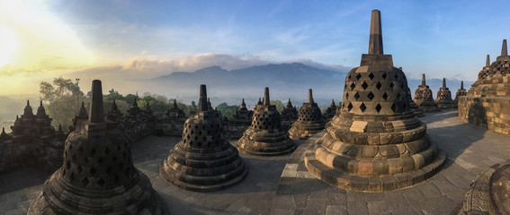 Spoed Fotobehang Bedehuis Panorama of Borobudur sacred temple, stunning ancient temple with black stone bells (stupa) in yogyakarta, Java, Indonesia.