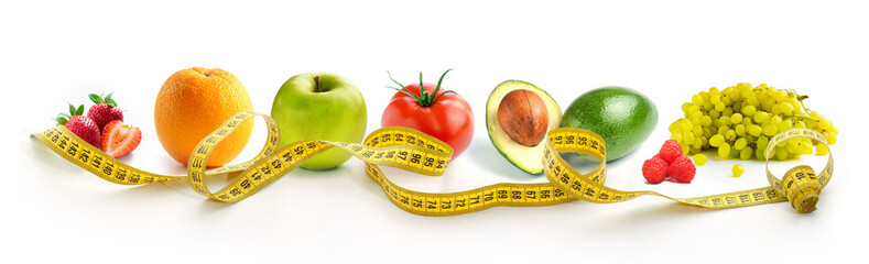 Vegetables and fruits for weight loss with a measuring tape on a white background. horizontal photograph of a tailor centimeter on a completely white background