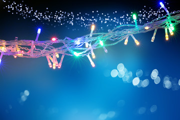 Beautiful background with Christmas light garland with copy space. Holidays concept.